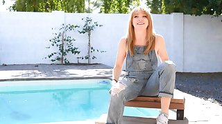 Solo video of redhead cutie Nikole witty transmitted to brush boobs by transmitted to pool